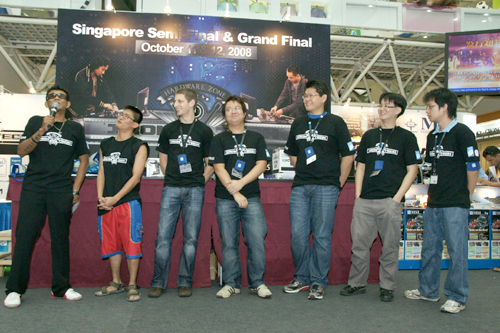 Our emcee for the day introduces the six contestants, striving for the privilege to duke it out with their fellow regional overclockers in the Iron Tech 2008 Grand Finals. Second from the left to right: Ng Soon Aik, Tim Marshall, Jeremiah Ong, Jeremy Chew, Chen Tianyi and Randy Hong.