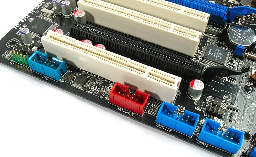Along the sides of the P5K/P5K3 Deluxe, you'll find additional USB 2.0, FireWire-400 and COM port headers. There doesn't seem to be parallel port support at all on the two boards.