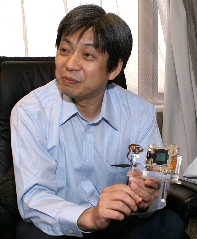 In his hands, Mr. Keiichi Ishizuka holds the Alpha A700's CMOS sensor module.