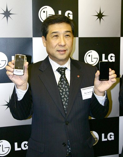 In the hands of Mr. Jae Bae are the shining stars of LG, the Shine (left) and PRADA phone (right).