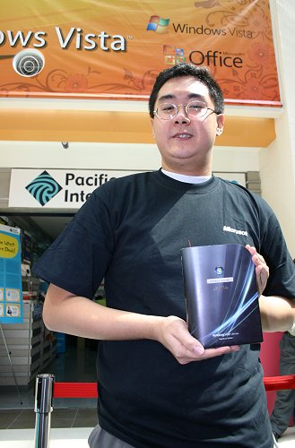 Nevertheless, you could tell he was a happy man having received the signature edition for being the first to buy the latest operating system from Microsoft.