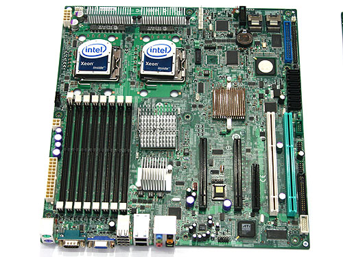 The upcoming Intel Stoakley platform featuring the upcoming Seaburg chipset. This board will support four-channels of memory with its eight FB-DIMM slots. It comes with two PCIe x16 slots, one PCIe x8, two PCI-X and 7.1-channel HD audio.