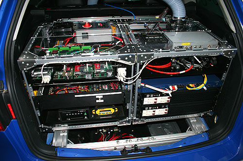 Two computers are mounted at the boot compartment of the car, along with controllers, power supplies and network switches.