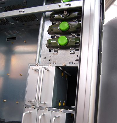 The 5.25-inch expansion bays have a new button mechanism to lock/release any drive installed. For 3.5-inch hard drives, there are six individual detachable enclosures equipped with thermal pads. This design however requires careful cable routing and to hook it up or disconnect the connections, you would require accessing the other side of the case - not exactly convenient though.