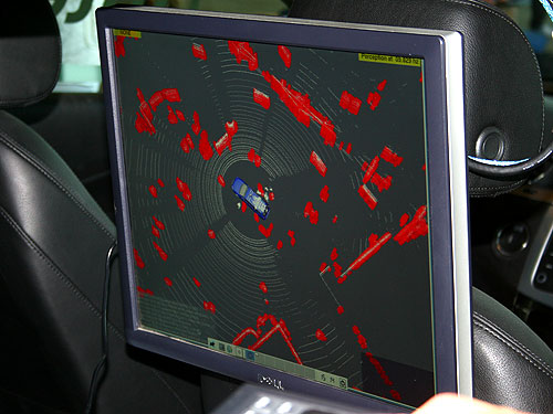 The laser system on the roof helps detect obstacles with 360 degrees view. Obstacles are indicated in red.