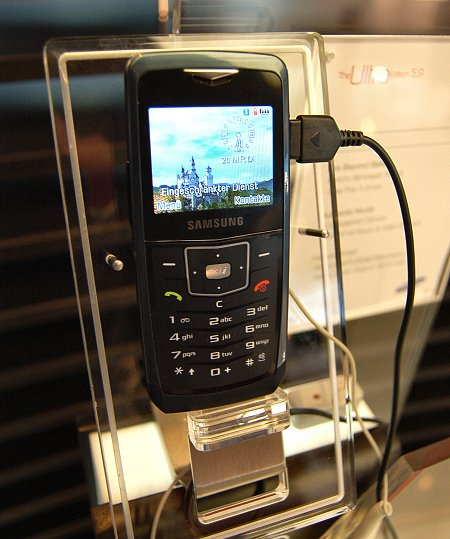 "The Samsung Ultra II 5.9 edition model (U100), dubbed the world's slimmest phone, was also shown in Barcelona and again at CeBIT 2007. Supporting EDGE, GPRS Class 10 with triband network frequency support (900/1800/1900MHz), the U100 comes with a 3-megapixel camera with Auto Focus, 1.93"" 220 x 176) display with features similar to the 10.9 edition. While it supports only Bluetooth, it has USB 2.0, Smart Search and Background Music Play. It has no memory slot but a built-in memory of 70MB, and measures 105.5 x 50 x 5.9mm."