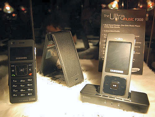 The Samsung Ultra Music F300 is one sexy phone, though we felt the screen on the 'phone' side was slightly on the small side. You can also see the speaker dock (sold separately) under the Ultra Music F300 in this picture (right). The leathercase (middle) has its own battery and will extend the battery life of the phone when slipped on.