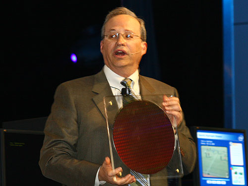 Justin Rattner, Intel Corporate Technology Officer, holds up a 45nm Penryn wafer during his keynote at the Intel Developer Forum in Beijing on Tuesday.