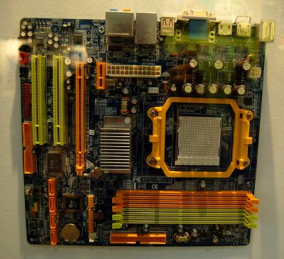 Here's an NVIDIA based competitor to the prior board. This is using the single-chip GeForce 7050 + nForce 630a chipset. The board layout might not be as ideal and it lacks DVI output, but it oddly supports up to 8GB of system memory. Till we test-run a GeForce 70xx based IGP chipset, it would be difficult to say which side to lean to, but that should be known real soon.