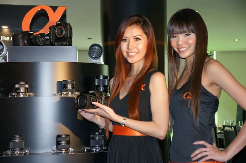 Models displaying the new camera in front of the Sony's full range of lenses that include four new additions from the Sony and Carl Zeiss partnership.