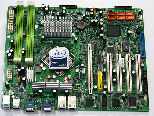 The upcoming Garlow platform for future 45nm Xeon processors in the 3000 series. This board will come with Intel's Bigby chipset and will support dual channel unbuffered DDR2 memory, one PCIe x16, one PCIe x8, four PCI slots, two Gigabit Ethernet ports and on-board XGI Z7 graphics.