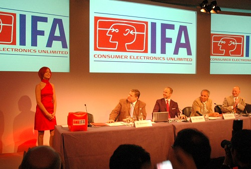 The Pre-IFA 2007 Press Conference kicked off with a reception on April 27 and a sit-down conference on April 28, 2007 in Monte Carlo, Monaco with the introduction of a new Miss IFA, seen here opening the conference. She is looked on by panelists (from left): Dave Graveline, Chief Editor and Producer of Into Tomorrow, USA (chairing the panel discussion), Dr. Christian Goke, Chief Operating Officer of Messe Berlin; Hans-Joachim Kamp, Advisory Board gfu; CEO Philips Germany/Austria/Switzerland and Vice President of ZVEI, and Jurgen Boyny, the Division Manager of GfK Marketing Services.