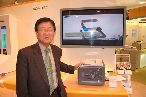 Mr. Park Sang Jin, President and CEO of Samsung Asia (Southeast Asia and Oceania), standing next to a demo station of the Samsung CLP-300N, the company's flagship personal color laser printer, that has spearheaded Samsung's successful foray into the laser printing market. Inspiring the emergence of the CLX-3160N and CLX-2160N color laser AIOs, the CLP-300N is set to be remembered as the 'little laser printer that could'.