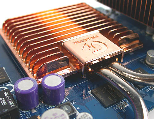 The copper heatsink over the GPU. Notice the two heat pipes leading from it to the radiators.