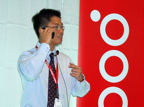Winston Goh, Product Marketing Manager, demonstrating internet telephony on Dopod phones.