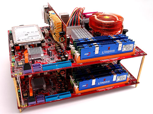 The two motherboards are stacked on top of one another using spacers. Note that the systems are only using passive coolers.
