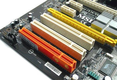 Expansion slots aplenty with the familiar orange 'Communications' PCI slot.