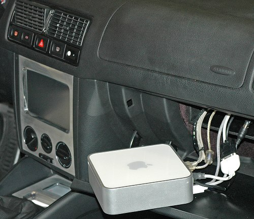Fancy having a computer in your car? Why not put the whole Mac mini in like this Buick Riviera.