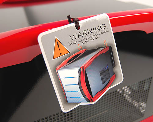 AOpen warns users against carrying the G325 by the red arches. Don't say you weren't warned.