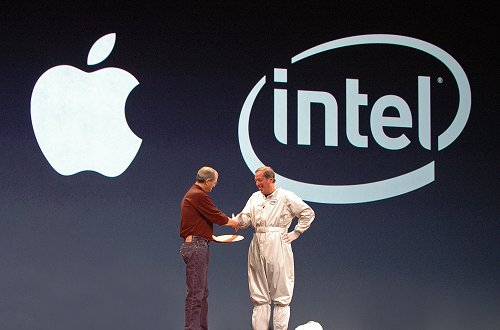 Both shake hands to commemorate a successful partnership and a new era of computing power for the Mac community.