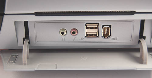 Opens up to show the usual ports (USB2.0, audio, FireWire) that most casings have nowadays.