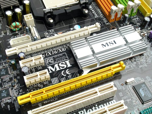 Definitely not an SLI board, but this configuration can be used as a dual graphics board (though not all cards would be compatible with the secondary slot). The yellow slot only supports x1 speeds, so treat the K9N Platinum as having three PCIe x1 slots and you're set. Despite the long passive heatsink for the chipset, the nForce 500 series chipsets generally operate hot, so just be wary of that.