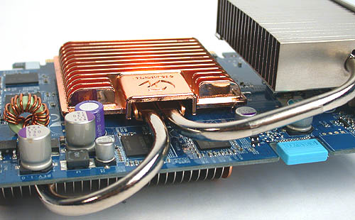Two heat pipes conduct heat from the core to the back radiator and the exhaust at the rear of the card.