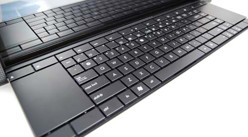 The keys are laid out in an isolated style, and the trackpads are located on both ends instead of below the keyboard.