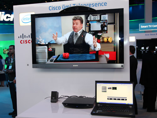 Demonstration of the Cisco Umi video conferencing device which lets you make video calls at full 1080p resolution. Seen here, a magician from Los Angeles performing live tricks to CES visitors in Las Vegas.