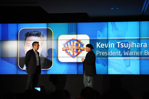 Kevin Tsujihara, Warner Home Entertainment Group President (left), explains to Mooly Eden, vice president and general manager, PC Client Group at Intel (right), the importance of Intel Insider in the delivery of content securely through the internet.
