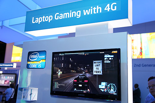 Gaming online on the laptop with 4G/WiMAX connection. Seen here a Sandy Bridge laptop running Need For Speed World online game.