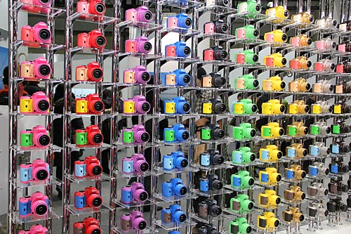 No prize for guessing whom this colorful camera wall belongs to. Why, Pentax of course. The camera used is the K-r.