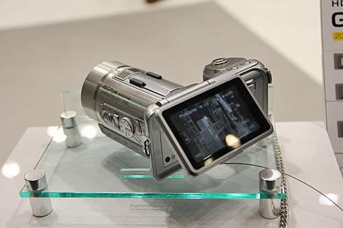This is the JVC GC-PX1. It's a camcorder that shoots 1080p (60 fps) videos at 36 Mbps, and still photos at 10 megapixels. It's equipped with a 10x optical zoom lens (38.5 - 385 mm in 35 mm equivalent), 32 GB internal storage, 3-inch touch LCD, and JVC's FalconBird image processor.