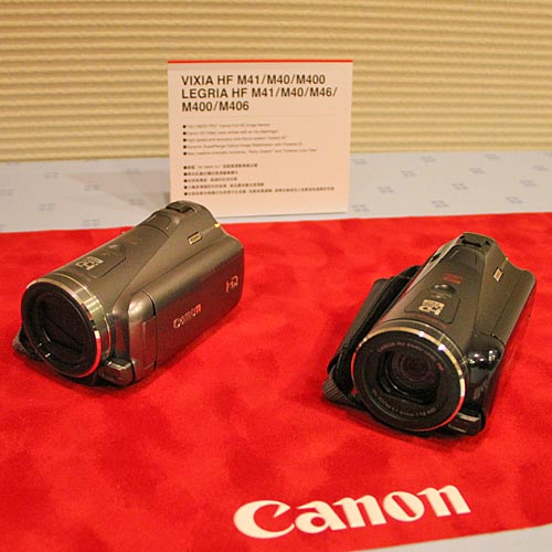 The LEGRIA HF M41 (black) and M400 (silver) are Full HD 1920 x 1080, flash memory camcorders that use Canon's large HD CMOS Pro sensor (2.07 megapixels for movie), and a video lens that has an iris diaphragm. Both models come with two SD slots, Relay Recording function that switches recording from one card to the next automatically, high quality microphone, Canon's new Story Creator, Cinema-Look Filters, and Touch Decoration functions. The M41 also has a sliding, 260,000-dot electronic viewfinder and 32 GB internal memory.
