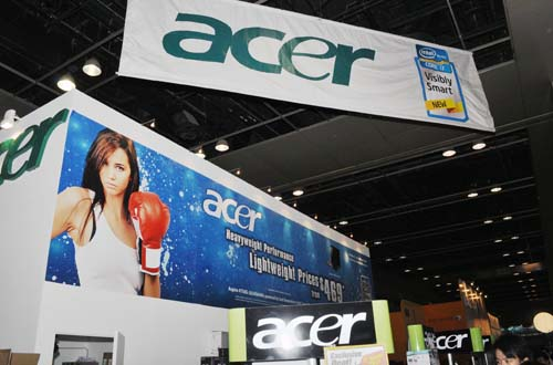 Despite her sultry looks and boxing gloves, she isn't going to punch you in the face when you pop by the Acer booth, so don't be shy/scared!