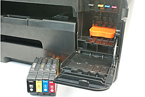 The MFC-J6910DW's four ink cartridges go behind a cover at the bottom right of the AIO. The orange part serves to protect the ink tubes in the AIO; you'd need to remove it before installing the cartridges. There's a cavity under the scanner unit for housing it.