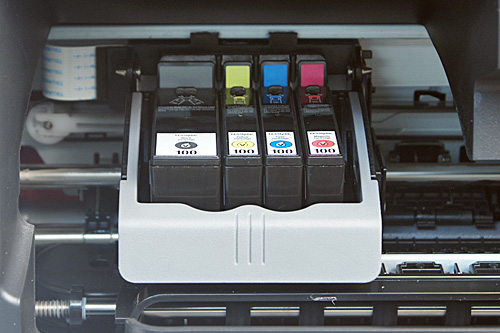The Genesis S815 uses four separate ink cartridges for each of the colors (cyan, magenta, yellow and black). The print head access door sits just above the output tray.