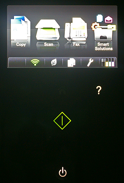 "Most of the setting adjustments are done using the 4.3-inch touchscreen LCD. Below it are a few touch ""buttons"" that light up selectively depending on the mode or menu you're in. The Help and Start buttons are shown here; other buttons include Back, Home and Cancel. The only tactile button is the Power button at the bottom."