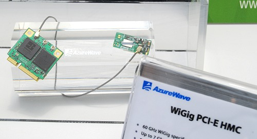 And here she is - the world's first WiGig PCIe device. Its maximum transmission throughput is up to 7Gbps! Looking like any other wireless solution in appearances, this extremely high transmission rate is possible thanks to the new 60GHz operational spectrum in addition to simultaneously working on the 2.4GHz and the 5GHz bands. Tri-band Wi-Fi anyone? We surely like the sound of that and probably saying good riddance to wired networking for the masses.