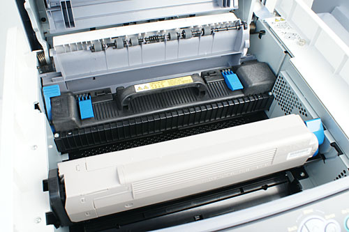 Lifting the top cover reveals the fuser unit (black contraption with handle) and the toner cartridge.