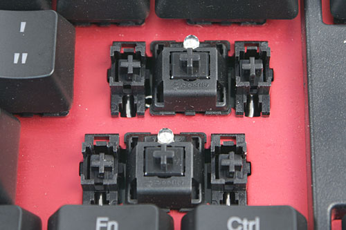 The keyboard that we received uses the Cherry MX Black switches. For elongated keys such as the spacebar, Shift and Enter keys, proxy switches are used on either side of the real key-switch to stabilize the key. You can also see where the LED is inserted.