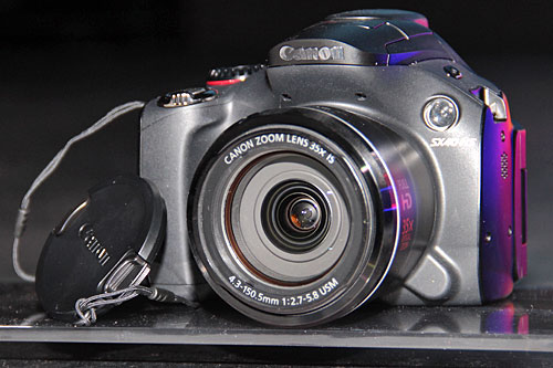 The PowerShot SX40 HS is a 35x (24-840mm) zoom camera with manual exposure control. It makes for a great all-in-one camera.