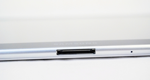 Located at the bottom section of the Samsung Galaxy Tab 10.1 is the proprietary connector port for charging and data transfer, with a microphone pinhole for video chat situated just beside it. Proprietary connectors are not a welcoming point, but that's something you just have to make do with this tablet unfortunately.