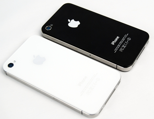 Although the backs of the iPhones look similar, the 8MP camera onboard the iPhone 4S (left) is more powerful than the 5MP one found on the iPhone 4 (right).