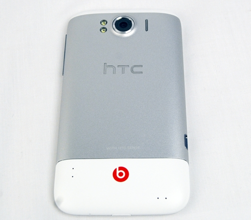 The striking red logo of Beats by Dr. Dre stands out on the white chassis of the HTC Sensation XL. Near the top, you can find the 8-megapixel camera which is flanked by the dual-LED flash on the left and speaker grille on the right.