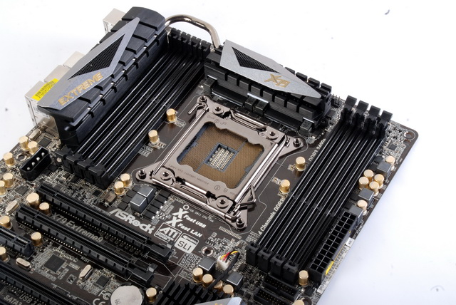 Shown here is the bulky passive cooling solution that surrounds the CPU socket region. The CPU socket is flanked by two sets of four DIMM slots that can support up to 64GB DDR3 at the maximum speed of 2400MHz when overclocked.