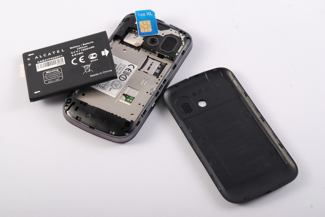 Obscured underneath the battery module is the slot for the microSD card. Also shown is the phone's slots for SIMs.