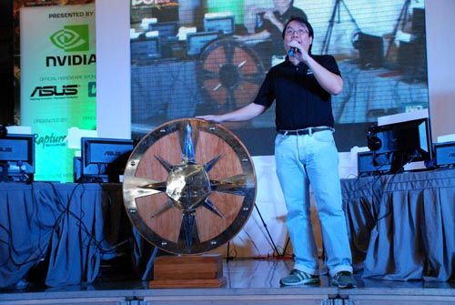 Glenn Paul Serrano, Field Support Representative for NVIDIA Philippines, reveals the Aegis trophy, which is to be won by the NCCL champions.