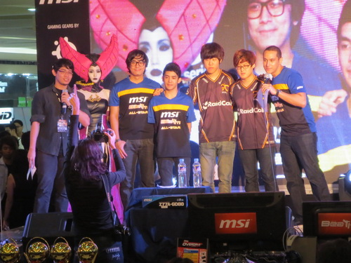 Some members of the Filipino eSports team Mineski and two gamers from South Korea.