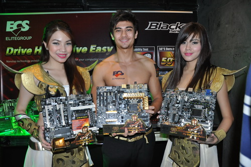 Models pose for the camera with ECS motherboards.